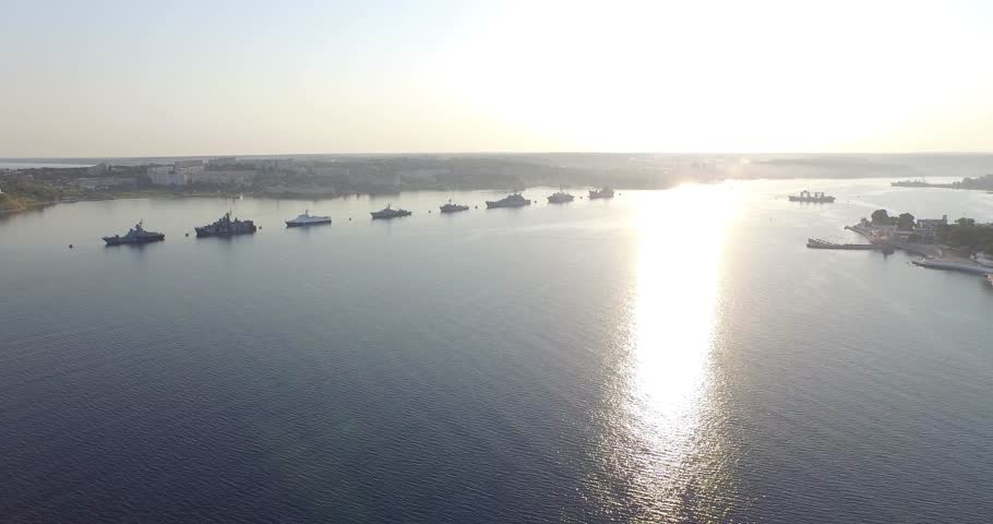 Shooting from the air of  Sevastopol bay, warships in the roads, Russian Navy Day 2015 | Shutterstock HD Video #1016330440