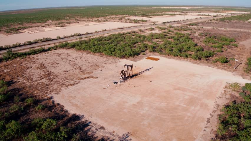 Cinematic Daytime Aerial Video of Oilfield Pumpjack