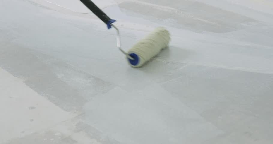 Slow motion applying primer on the floor