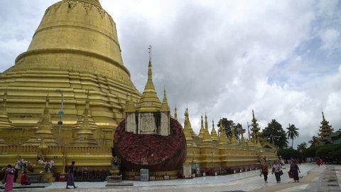 Bago, Myanmar - August 19, 2018 :Traveller praying and worship at Shwemawdaw pagoda, the tallest and beautiful pagoda in Bago, Myanmar