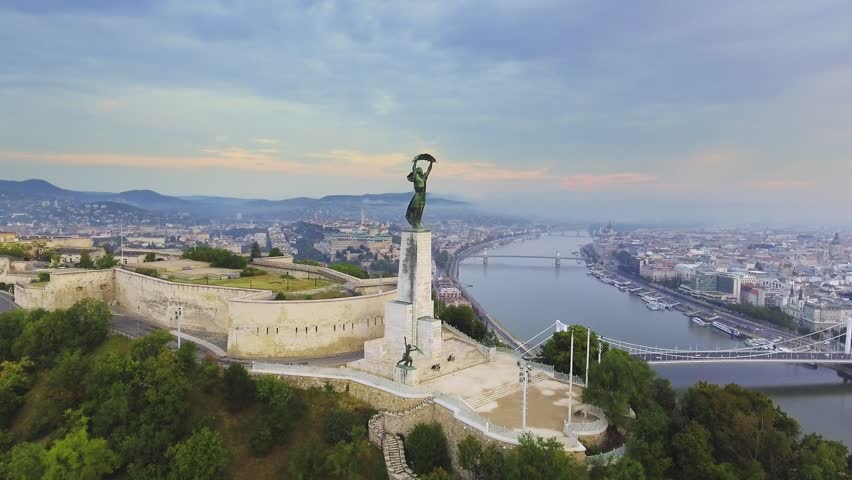 Hungary, Budapest - AUGUST 19, 2018: Budapest, Hungary - Sunrise, Aerial footage by the liberty statue | Shutterstock HD Video #1016437750