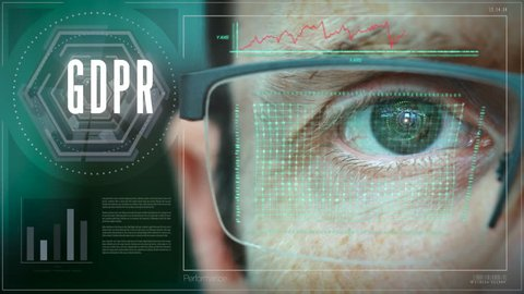 A close up of a businessman eye controlling a futuristic computer system with an GDPR concept.