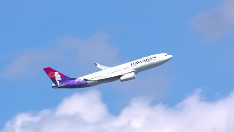 NEW YORK - 2018: Hawaiian Airlines Airbus A330-200 Commercial Jet Airplane Taking Off Flying into a Blue Sky with Clouds after Taking Off from JFK International Airport Enroute to Honolulu