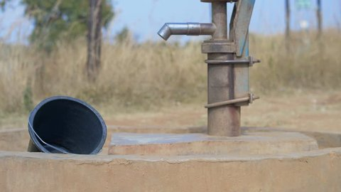 Static Shot of a Well and an Empty Bucket in Africa