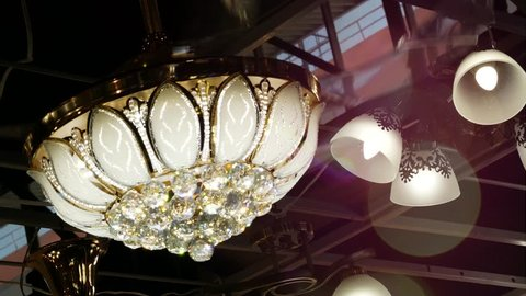 Chandelier with a fan in a classic style. Looks richly