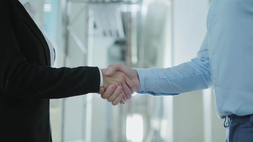 Two business partners shake their hands | Shutterstock HD Video #1016514100