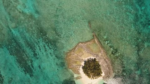 aerial footage tropical island with beach and palm trees lagoon with turquoise water Sea tropical landscape Guyam island, Philippines, Siargao. Travel concept Aerial video