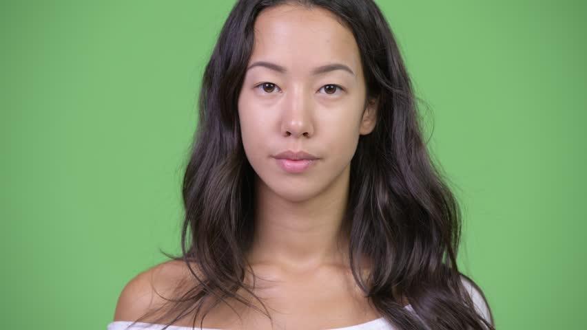 Head shot of young happy beautiful multi-ethnic woman smiling | Shutterstock HD Video #1016554900