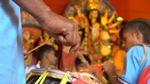 "KOLKATA, INDIA -SEPTEMBER 27, 2017 : Dhaakis (drummers) performing while hindu brahmin priests worshipping Durga - called ""aarti"", Durga Puja ritual. Biggest festival of Hinduism and Bengalis. 4K."