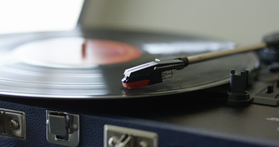 Record player playing vinyl very quickly - close up