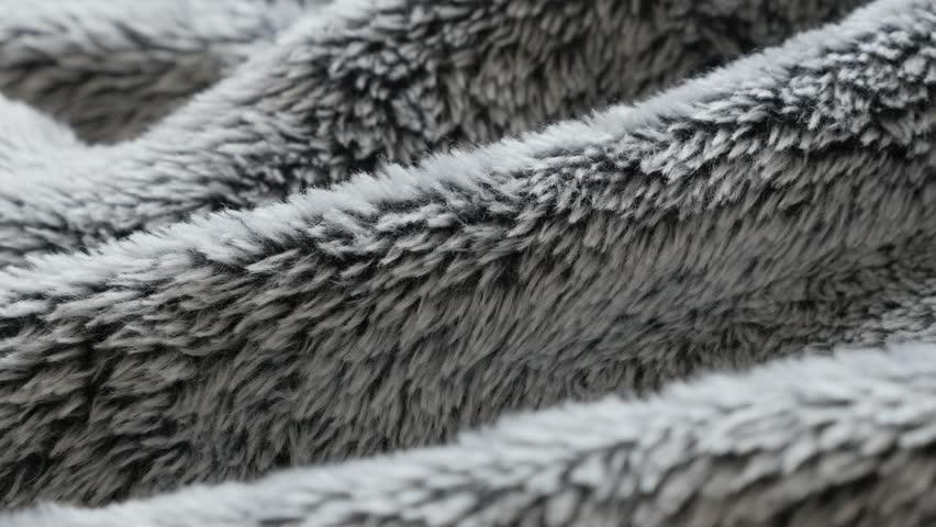 Gathered faux fur fabrics close-up slow pan 4K video