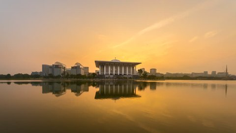 Time lapse of sunrise and clear sky at a mosque in Putrajaya, Malaysia with beautiful reflection in water from night to day. Prores Full HD 1080p.