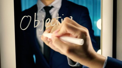 Smart business man writing the word Objective Mission on the mirror board - Objective Mission business text letter