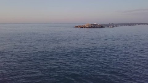 Harbour view in spanish coastal city during sunrise - fly forward
