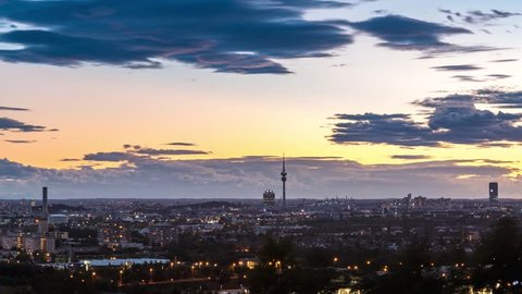 Munich Skyline day to night time lapse Germany, Bavaria. View of old town and Olympic Park Munich with TV Tower.
