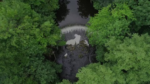 Horseshoe weir view from above. An aerial video of a horseshoe weir on a British river