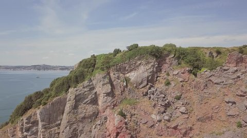 Aerial Dolly out of a cliffside near Torquay, South West England