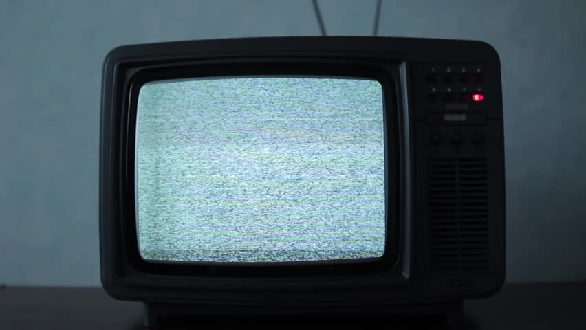 Static noise on a vintage TV set in a dark room | Shutterstock HD Video #1016839330