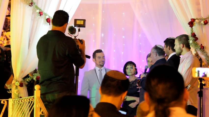 Tel Aviv, Israel - June 29, 2016: Jewish traditions wedding ceremony under chuppah. Drink some wine