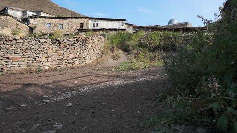 Abandoned village part. Summer morning. Camera panning