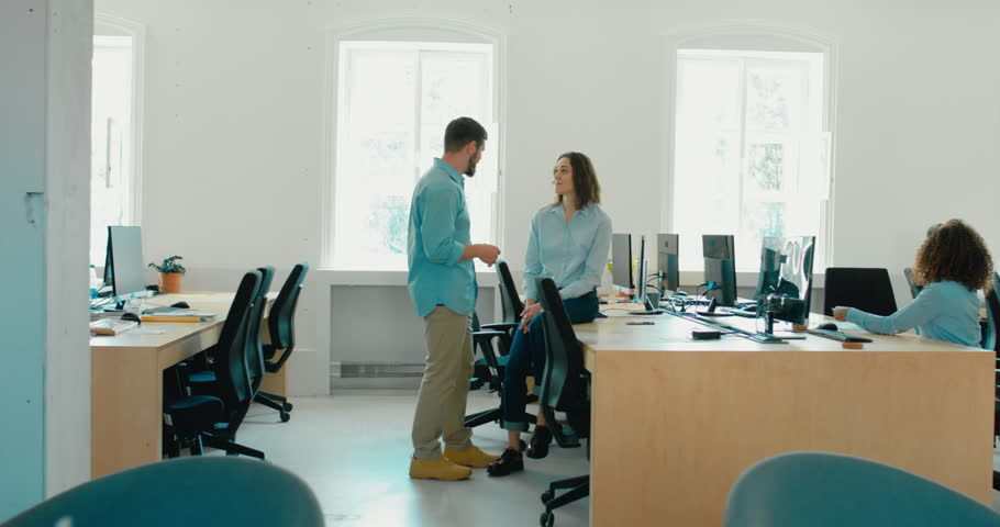LR DOLLY WIDE office workers communicating together and discussing a projects in busy office. 4K UHD 60 FPS SLOW MOTION | Shutterstock HD Video #1016917780
