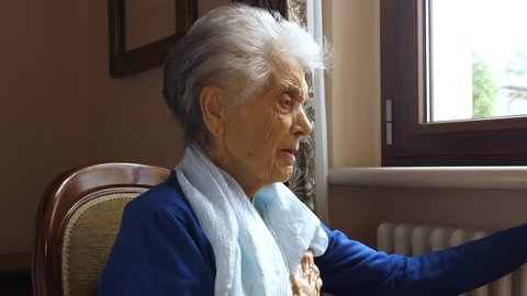 Old caucasian woman with heart attack, chest pain. Loneliness and abandonment concept