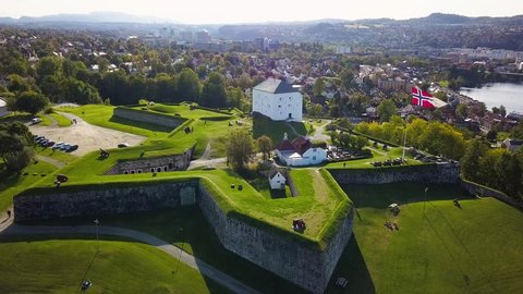Aerial Capture of the Ancient Fortress in Trondheim, Norway - Sunny Summer Day with an overview of the city