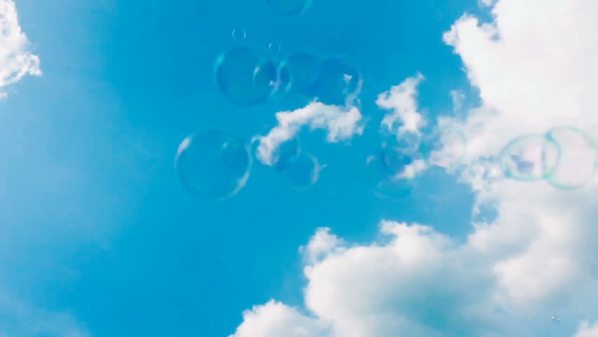 Soap bubbles and blue sky for lovely background | Shutterstock HD Video #1017017410