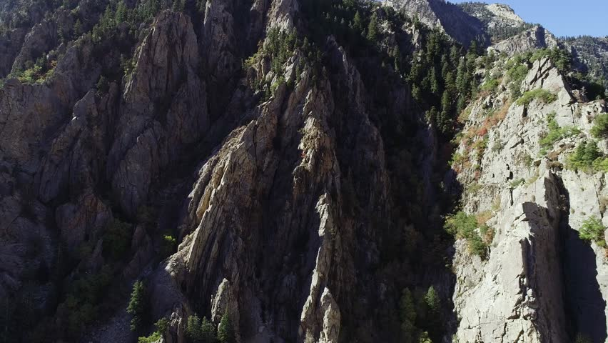 An amazing aerial shot of intense granite cliffs in Big Cottonwood Canyon near Salt Lake City in the summertime
