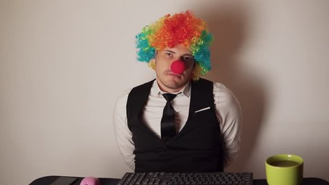 Office worker in clown wig, clown concept at work. Businessman with clown wig isolated on white