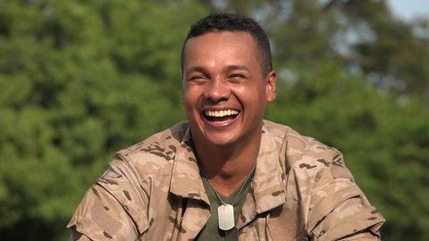 Happy Hispanic Male Soldier Wearing Camo