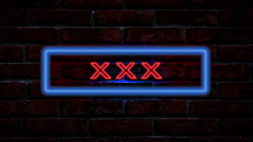 XXX neon sign at wall in the night