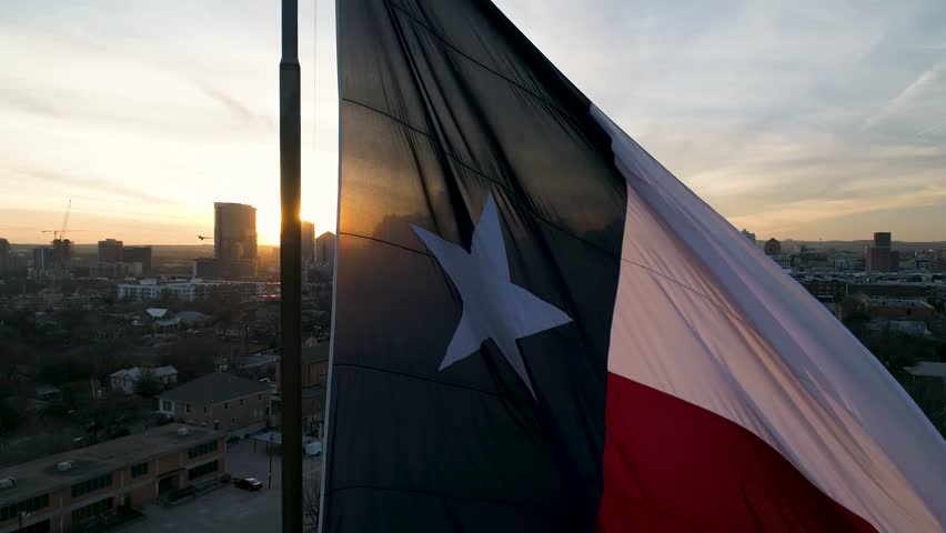 4K Texas Flag Slowly Blows in Breeze at Sunset in Austin