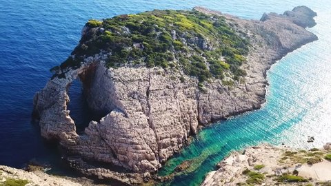 Aerial drone video of iconic fjord rocky seascape with emerald rocky seacape full of volcanic caves in Korakonisi, Zakynthos island, Ionian, Greece