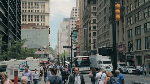 New York, United States - jun 22, 2016: Urban big city buildings and street New York City. Pedestrians walk along the street of New York. New York City Manhattan street at Midtown at sunny day.