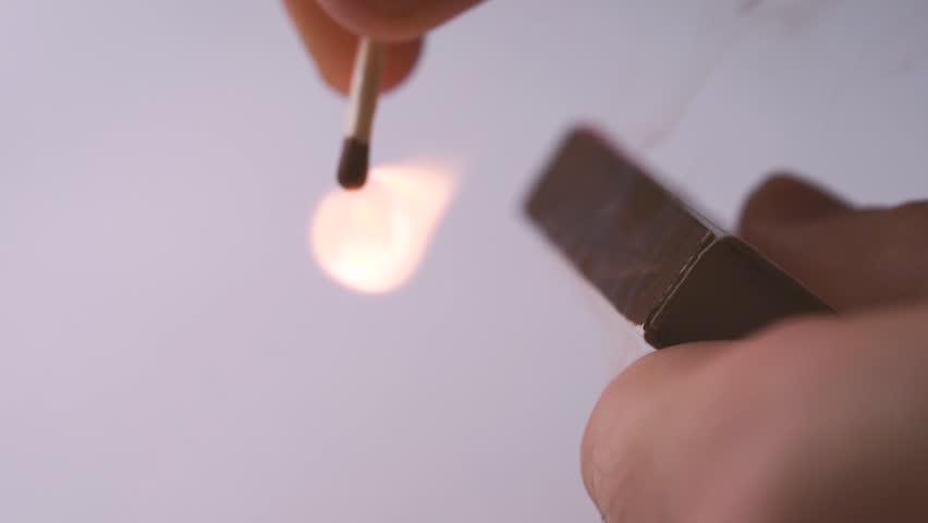 One quiet burning match. Match burning details