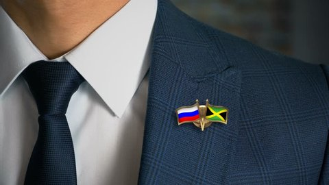 Businessman Walking Towards Camera With Friend Country Flags Pin Russia - Jamaica