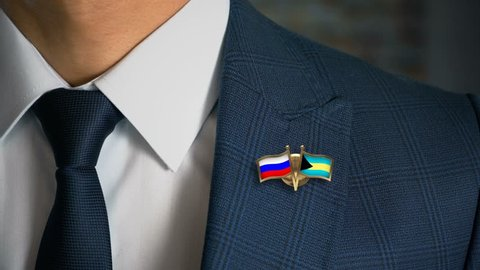 Businessman Walking Towards Camera With Friend Country Flags Pin Russia - Bahamas