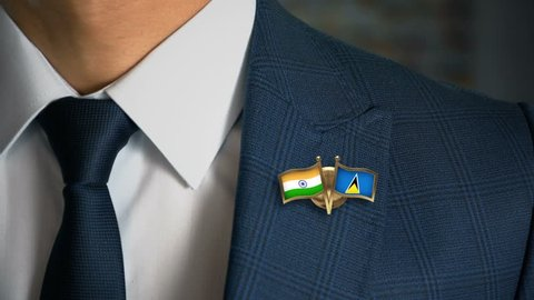 Businessman Walking Towards Camera With Friend Country Flags Pin India - Saint Lucia