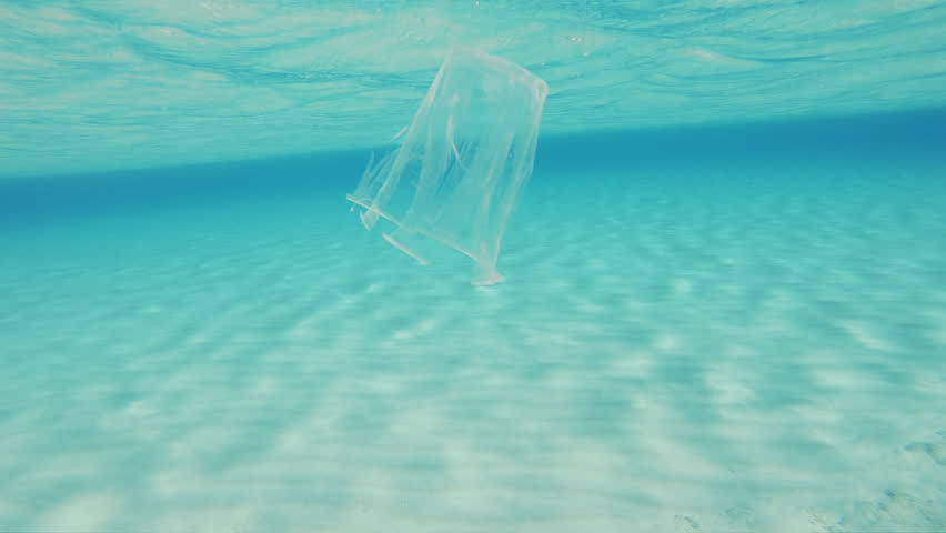 Plastic Pollution Of The Sea. Decayed Plastic Cup Floating Underwater In The Mediterranean Sea