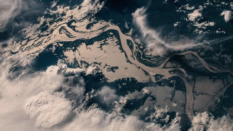 Aerial satellite view of sunset shadow on amazon river and forest animation. Contains public domain image by NASA/ESA