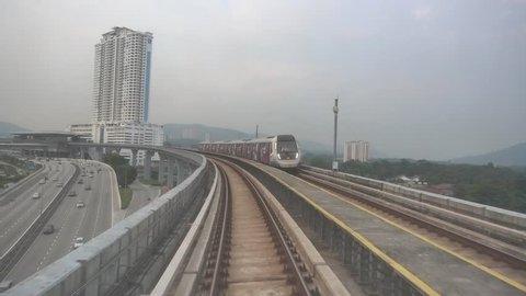 KUALA LUMPUR, MALAYSIA - OCTOBER 02, 2018 : Malaysia MRT (Mass Rapid Transit) train with background of Kuala Lumpur city. MRT bring Malaysia as a developed country.