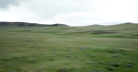 Aerial footage of Pronghorn Antelope grazing and running through grasslands of  Wyoming.