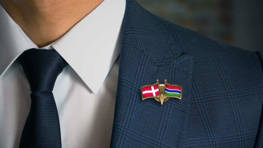 Businessman Walking Towards Camera With Friend Country Flags Pin Denmark - Gambia