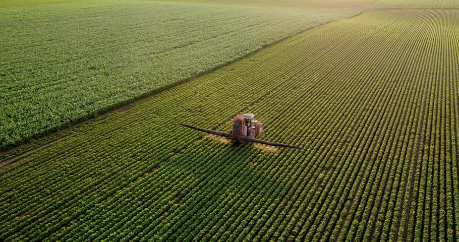 Aerial drone shot of a farmer spraying soybean fields | Shutterstock HD Video #1017454060