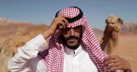 An Arab Bedouin Man bandage his  Traditional hair cover In The Wadi Rum, Jordan