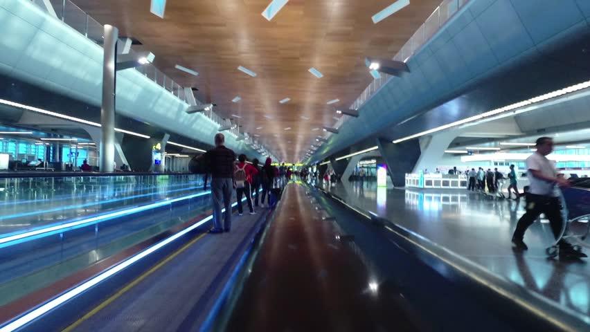 Doha/ Qatar-July 2018: Doha International Airport, people in terminal, motion timelapse