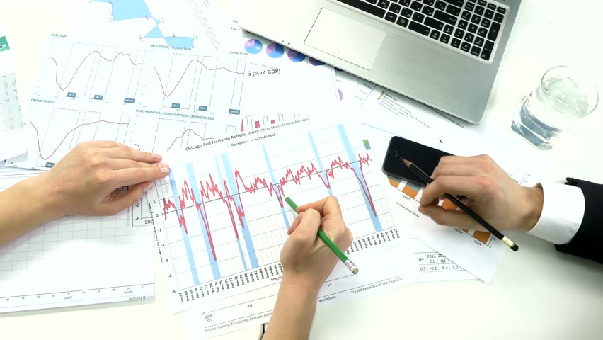 Business peoples developing a business project and analyzing market data information. | Shutterstock HD Video #10174880