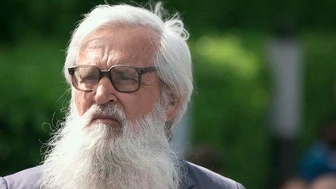 09.05.2018, Ukraine, Kiev. Portrait of old senior bearded man. Long white beard and glasses.
