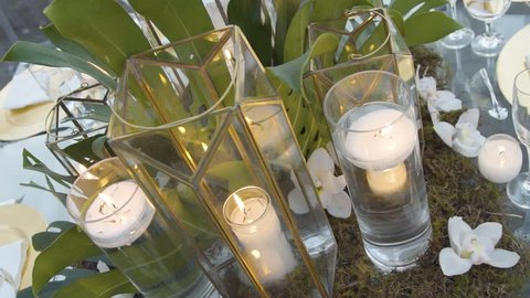 Table decoration of a candel inside a glass of a wedding party.